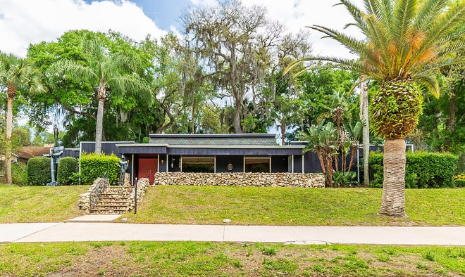 This mid-century modern stunner is located in the desirable community of Tomoka Oaks, where the houses all have their own personality and style.