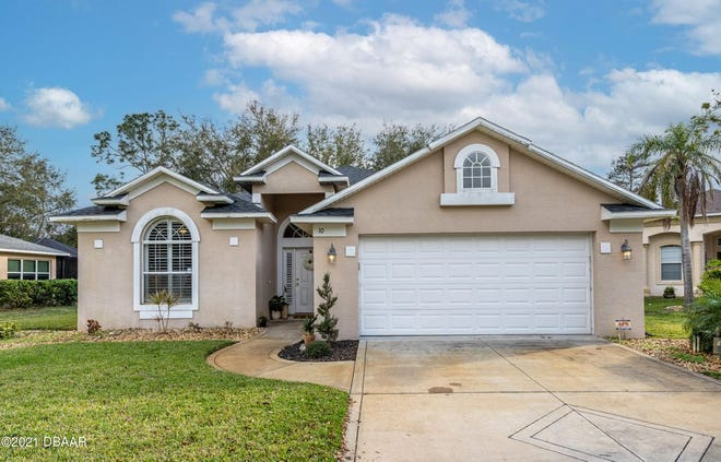 This three-bedroom, two-bath, two-car-garage home is nestled on a quiet cul-de-sac in the beautiful community of Ormond Lakes.