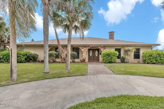 Enjoy river breezes and spring-time sunsets from the Intracoastal Waterway on the pavered rear deck of this John Anderson Drive home.