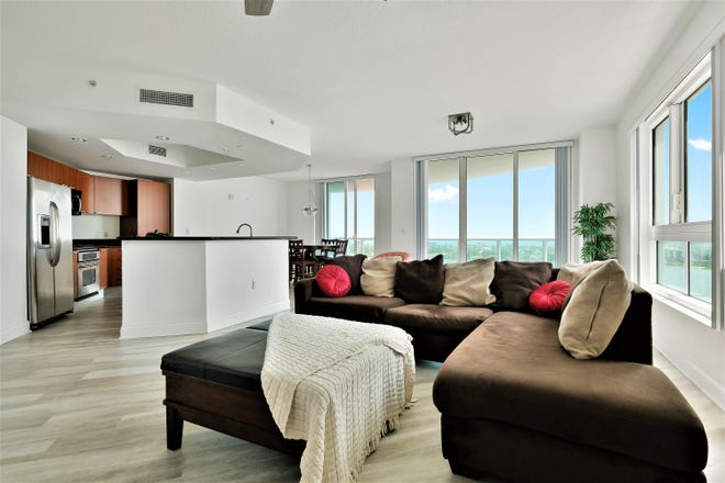 This turn-key Marina Grande condo boasts 9-foot ceilings, impact-resistant windows and doors and jaw-dropping views from every room, including the great room and gourmet kitchen.