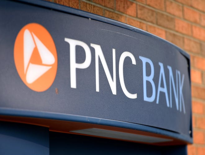 A PNC Bank logo is shown at a former branch location on Polar Street. The Pittsburgh-based bank announced Monday that it is raising its minimum wage from $15 to $18 an hour.