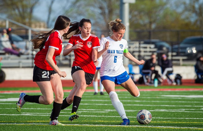 Grain Valley senior midfielder Raena Childers (6) takes a shot on goal as Fort Osage defenders Kaia Duncan, left, and Emma Le converge in a game earlier this season. Childers, a Kansas signee, has scored 55 goals this season while leading a young Eagles team to Saturday's Class 3 state quarterfinal.