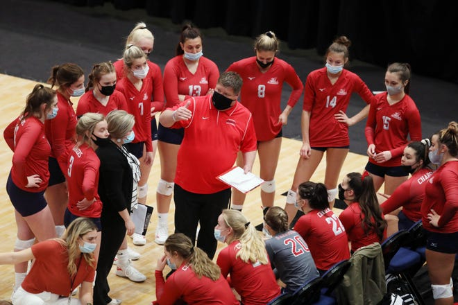 Carl Sandburg College volleyball head coach Todd Winkler talks with his players during their first round NJCAA Division II National Tournament game against Iowa Western Community College Tuesday April 13, 2021 at the Alliant Energy PowerHouse arena in Cedar Rapids.