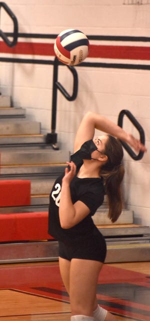 Zoe Larkins of Orion serves during the varsity match with Galesburg on Saturday, April 10, in the Charger gym