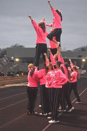 Orion cheerleaders form a pyramid between the first and second quarters of the varsity football game with Princeton on Friday, April 9, at Charger Field.