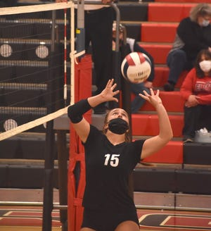 Orion's Ashley Awbrey sets the ball in the second game of the varsity match with Galesburg on Saturday, April 10, in the Charger gym.