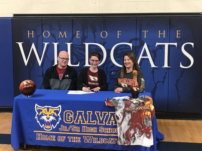 Matt and Courtney Jones look on as their daughter, Abigail signs a letter of intent to bowl at Coe College