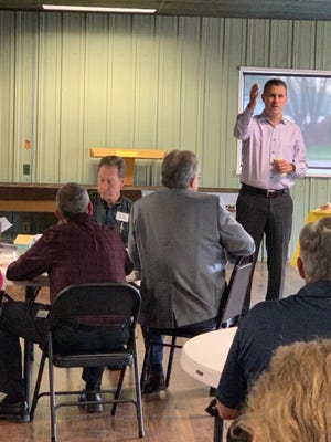State Senator Win Stoller (R-37) speaks to the Henry County Economic Development Corporation in Cambridge April 7. Woodhull Mayor Dave Holmes in the foreground.