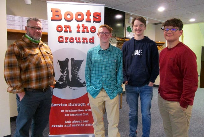 """Jamie Johnson, left, Justin Johnson, Will DeJohn and Bryce Johnson are hoping area men, young and old, will join them at the """"Boots on the Ground"""" Sunday school class at Grace United Methodist Church in Geneseo."""