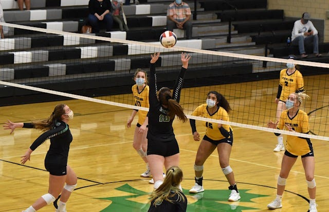 Addie Dunker, No.10, setting to Emma Frank, No. 24, with Esther Brown at right, at the volleyball matchup between Geneseo and Sterling at Geneseo.