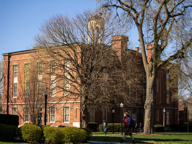 Students cross the Knox College campus on Tuesday, April 13, 2021.
