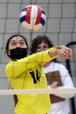 """Galesburg junior Kadynce Lydic returns a serve during the Silver Streaks' 2-1 loss to host Monmouth-Roseville on Monday, April 12, 2021 at """"The Shoebox""""."""