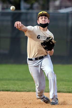 Galesburg High School senior Kadin Spencer makes the throw from second base during baseball practice on Tuesday, April 6, 2021 at Jim Sundberg Field.