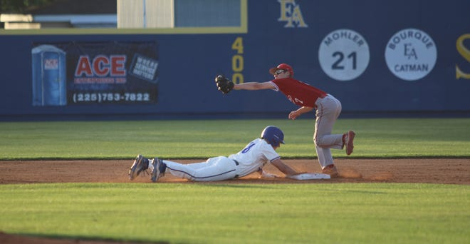 East Ascension's Brock Hebert slides in safely to second base during the Spartans' 2-1 loss to Central Catholic.