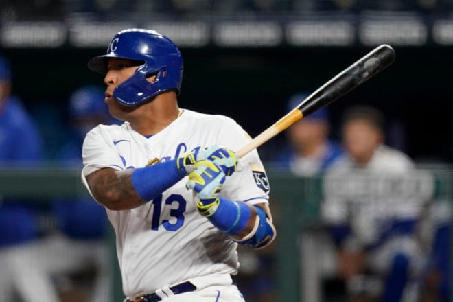 Kansas City Royals Salvador Perez gets his 1000th career hit during the sixth inning of a baseball game against the Los Angeles Angels at Kauffman Stadium in Kansas City, Mo., Monday, April 12, 2021. [AP Photo/Orlin Wagner]
