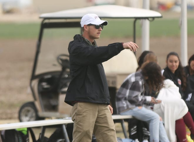 Hays High coach Tyler Rueschhoff directs the HHS soccer team on Monday against Junction City.