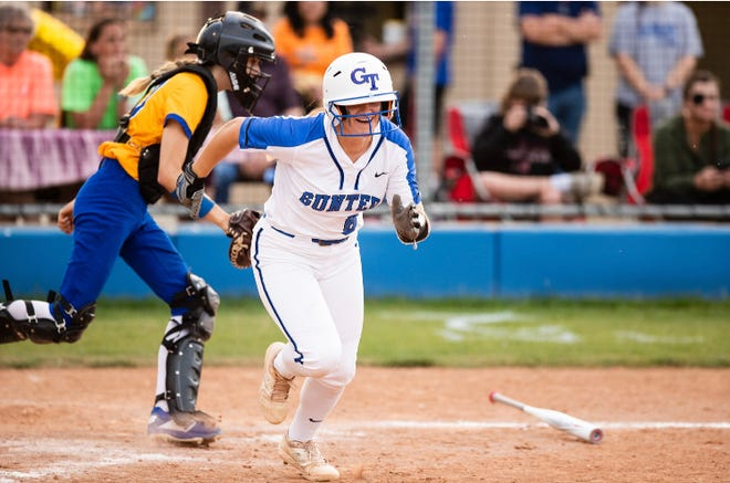 Gunter's Hayden Fox runs to first on her third hit of the day during a victory over Leonard in District 11-3A action.