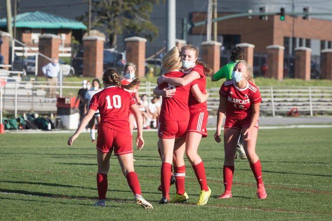 Hendersonville's Aubrey Bish hugs teammate Emma Jones (8) after Jones scored a goal against East Henderson earlier this season. [PAT SHRADER/ BLUERIDGEEXPRESSIONS.COM]