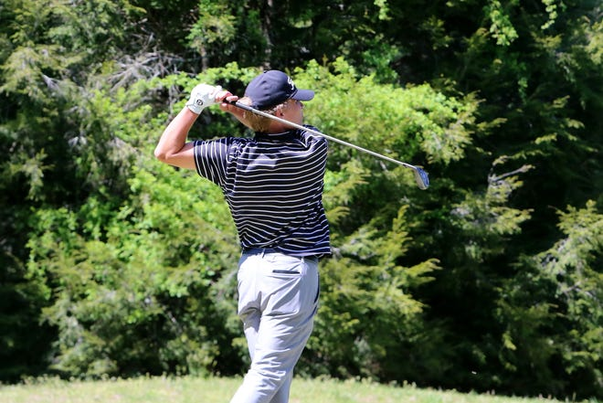 North Henderson's Aiden Dillingham watches his drive during Monday's Henderson County Championship at Etowah Valley Golf & Resort.