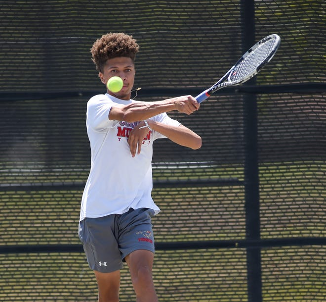 Coronado's Keon Arbuckle sends the ball over the net during the District 4-5A tennis tournament on Tuesday, April 13, 2021 at the Burgess Tennis Center in Lubbock, Texas.