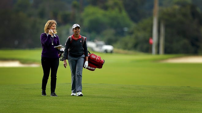 Beth Ann Nichols, left, of Golfweek chats with former Secretary of State Condoleezza Rice on a golf course in 2016.