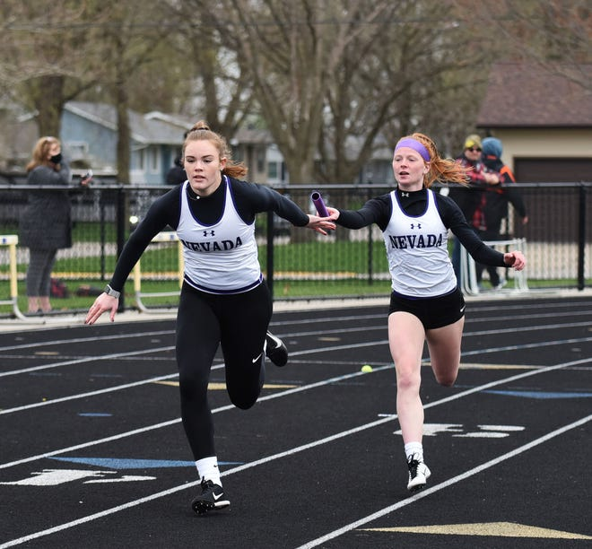 Hannah Thomsen, seen here taking the baton from Kylie Taylor in the sprint medley relay at the Nevada Co-Ed Invitational April 8, is one of several dual-sport athletes doing girls' track and soccer at Nevada. She and Addi Vorm are senior leaders for the younger dual-sport athletes to look up to as they attempt to excel in both sports.