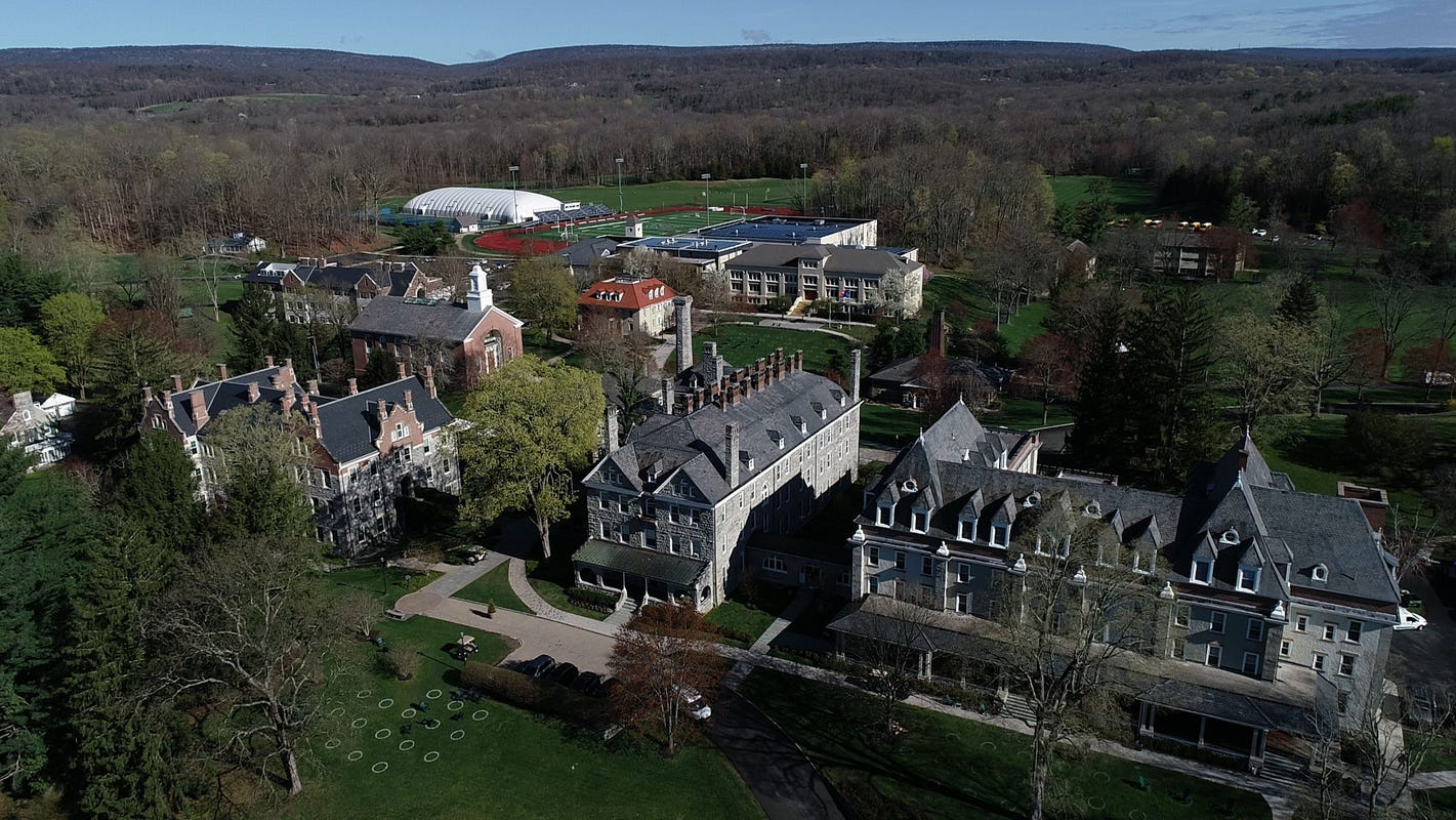 Former wrestler claims NJ boarding school turned blind eye to years of hazing, abuse