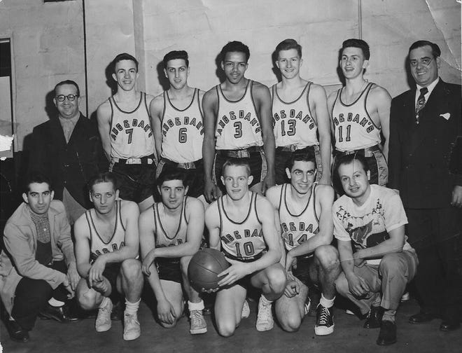 """It was March 1951 when Utica's Ang and Dan's basketball team journeyed to Little Falls to compete in the Gold Medal Tournament there. The team won all of its games in the Little Fall YMCA, including the last one for the championship against defending champions, Kozick Oilers of Rome. The winners – assembled by Coach Ed Pecorello – were made up of players from the Ang and Dan's squad in the Utica Municipal League and from area high schools. Standing from left: sponsor Dan Martinelli, Howie Kane, """"Butch"""" Giacovelli, Dick Frank, Bill Cobb, Bill Deck and manager Carl Nasto. Kneeling from left: Pecorello, Tom Rice, Chuck Collea, Dick Frye, John Nasto and assistant manager Mark Intino."""