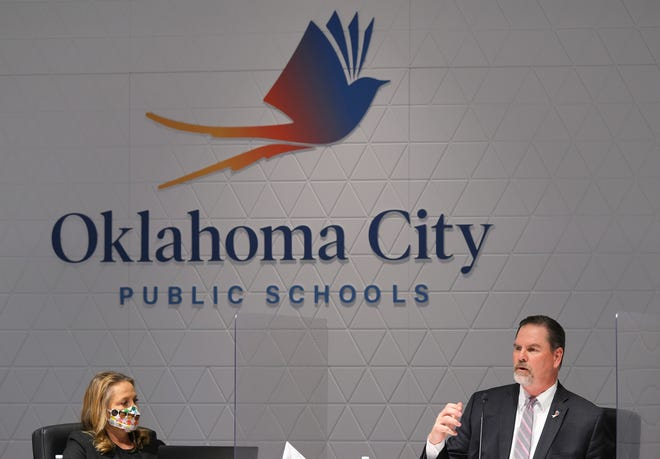 Paula Lewis listens to Sean McDaniel during the Oklahoma City Public School Board meeting Monday, April 12, 2021.