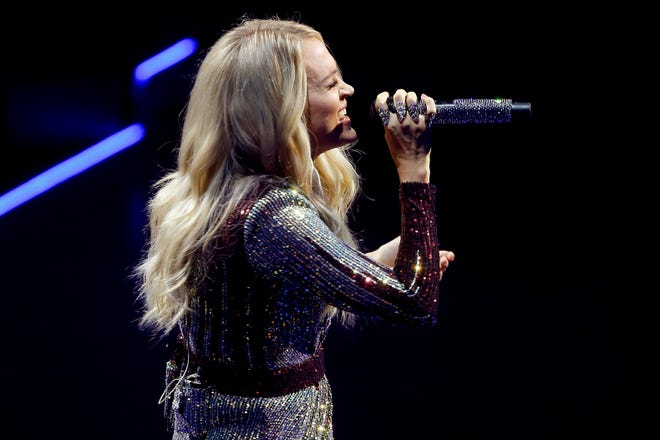 """Carrie Underwood performs in 2019 inside Chesapeake Energy Arena during her """"Cry Pretty Tour 360"""" in Oklahoma City."""
