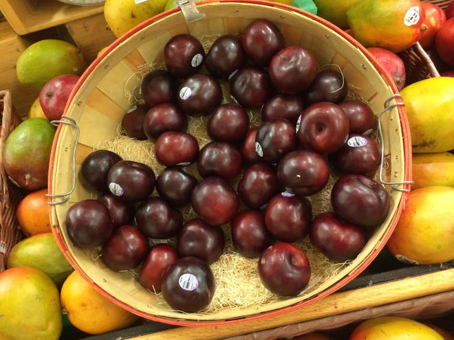 Overripe plums are the beginnings of a DIY project to attract butterflies.