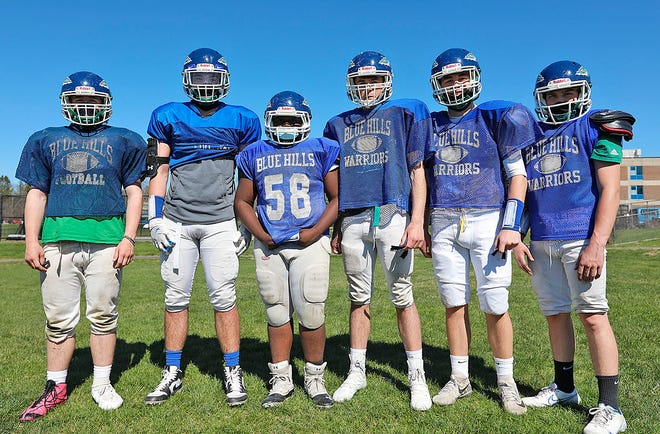 The Blue Hills High offensive line poses at practice on Tuesday, April 13, 2021. From left: right tackle Gabe Polito (Canton), right guard Liam Connor (Canton), center Stenley Simon (Randolph), left guard Connor Robertson (Norwood), left tackle John Ierardi (Avon) and tight end Thomas Taylor (Holbrook). Not pictured: tight end Joseph Dicalogero (Canton).