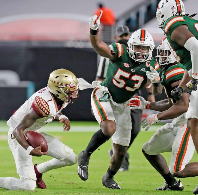 Miami's Zach McCloud (53) celebrates a sack of FSU quarterback James Blackman (1) during the Hurricanes' victory at at Hard Rock Stadium in Miami Gardens last season.