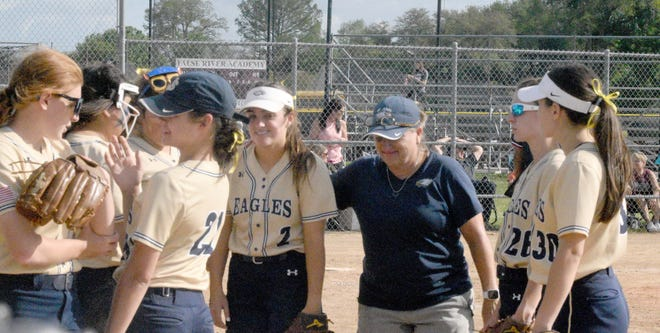 Coach Cindy Prouty and her St. John softball team have plenty reason to smile as of late. A win over longtime rival and area stronghold Ascension Catholic put the Eagles 14-4 for the season just before the playoff schedule begins.