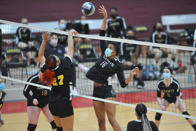 St. Raphael's Amaya Dowdy, right, is known for her size and skill on the basketball court. This spring the senior decided to play for the defending D-III champion volleyball team, as well.