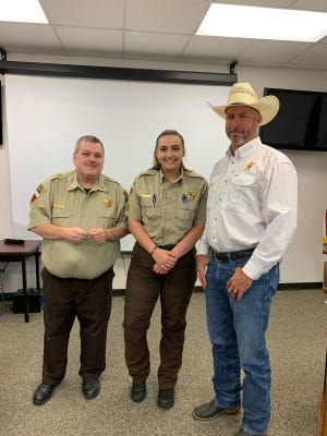 Sheriff Matt Coates, right, and Capt. Clayton announce the most recent promotion in the Erath County Sheriff's Office with Cpl. Taylor Williams, center, being promoted to the rank of sergeant.