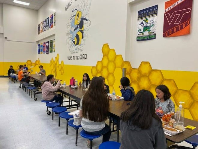 Gilbert Intermediate School students enjoy lunch in their newly painted cafeteria. The makeover is courtesy of the Stephenville High School National Art Honor Society.