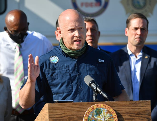 Noah Valenstein, secretary of the Florida Department of Environmental Protection, answers questions during a news conference Piney Point on Tuesday morning, April 13, 2031.  At the news conference, Gov. Ron DeSantis announced a plan to close down Piney Point.