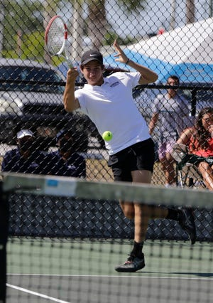 Riverview's Adrian Pawlowski plays a shot at No. 1 singles in the Class 4A-District 8 tennis tournament at Venice High.