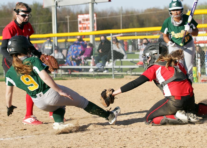 Colon catcher Jaden Adams tags out a Battle Creek Pennfield baserunner at home plate in the second game Tuesday evening.