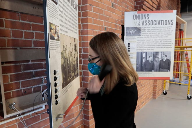 """In this file photo, Laura Orleans, director, tests out one of the many new audio content stations being installed inside of the New Bedford Fishing Heritage Center on Bethel Street in New Bedford, which is undergoing major renovations including the new exhibit, """"More than a Job: Work and Community in New Bedford's Commercial Fishing Industry."""""""
