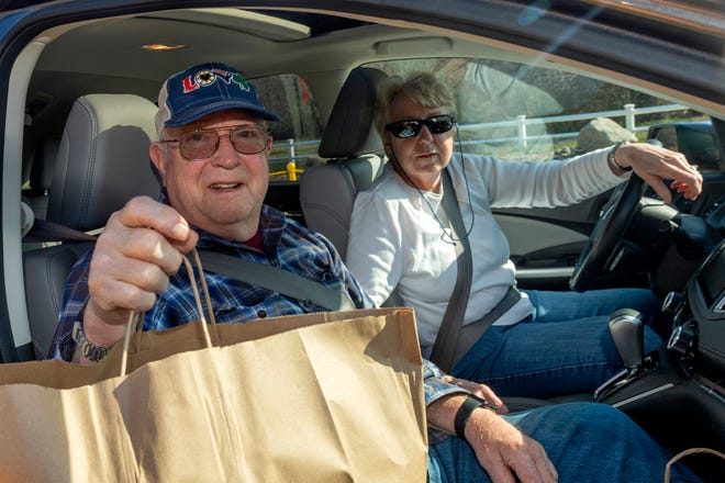 Ben and Donna Adams have dinner and a smile to go.