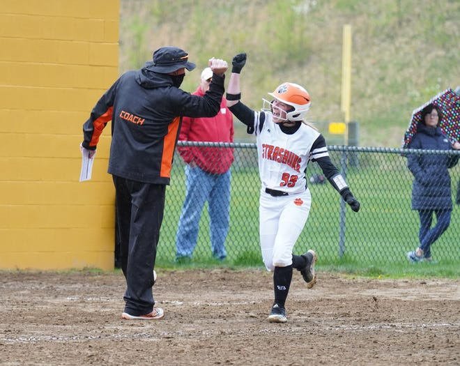 Strasburg's Lily Meyers celebrates her solo home run as she rounds third.
