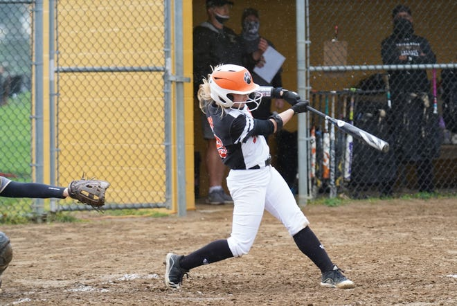 Strasburg's Lily Meyers strokes a solo home run against Tuscarawas Central Catholic Monday night.