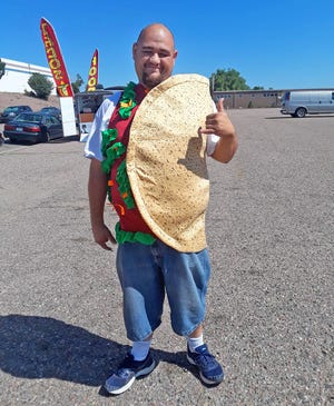 Louis Torres draws plenty of attention to his BLAST food truck when he wears his taco suit.