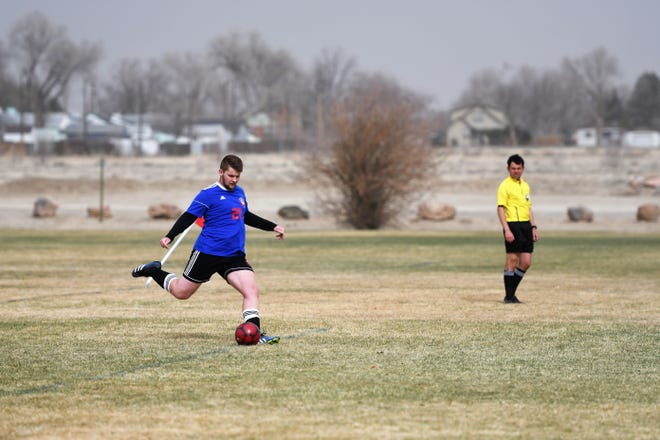 Swallows Charter Academy's Ben Compton kicks the ball in a game against Thomas MacLaren School last Tuesday.