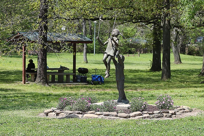 People set up for a picnic in Creekmore Park, Wednesday, April 13, in Fort Smith.