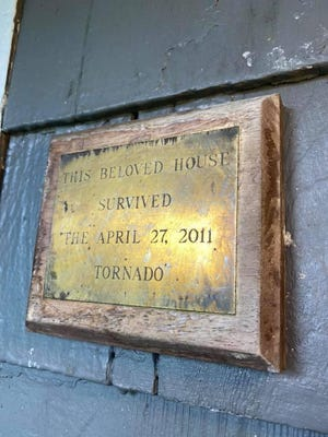 Lydia Seabol Avant's family installed this plaque at the house they lived at The Downs neighborhood during the April 27, 2011 tornado. [Photo by Lydia Seabol Avant]