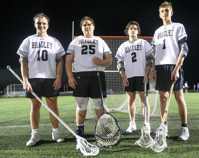Bradley seniors Zach Lehman (left), Liam Kennedy, Nathan Alting and Max Williams have been playing lacrosse together since the third grade.