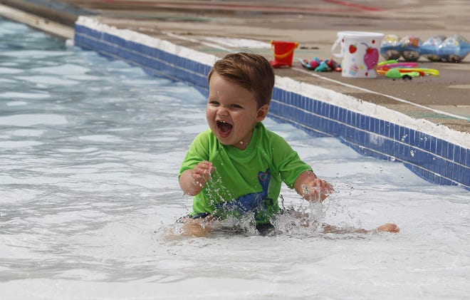 Tripp Paternostro, then 1, plays in the water at the Dublin Community Pool South on June 26, 2020. It was the first day of the season for the pool which had been closed because of the COVID-19 coronavirus pandemic.